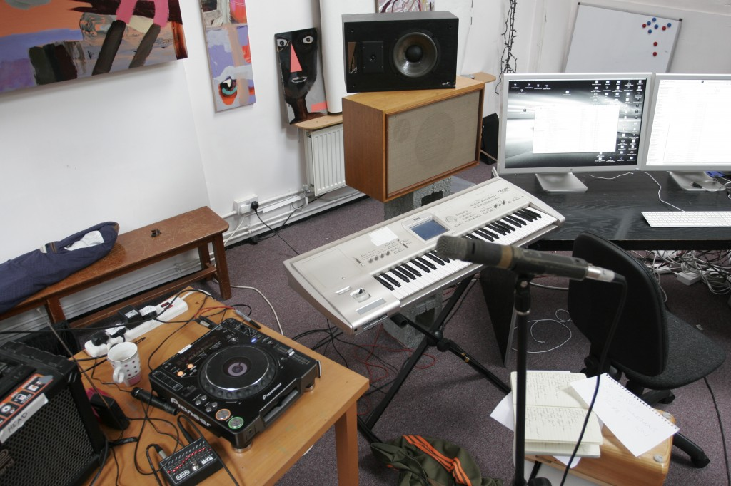 In this shot, Karl's table is on the left, an Korg workstation is in the centre and the DAW monitor screen is on the right. Karl's Shure SM57 vocal mic is on the stand in the foreground
