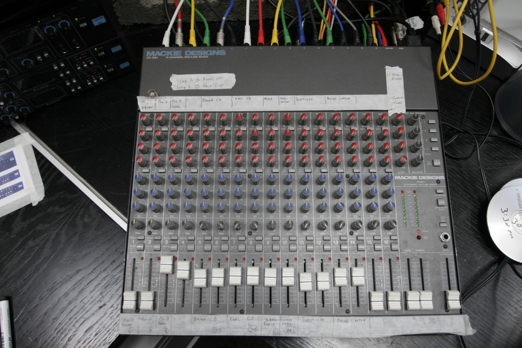 The Mackie mixer was used to control the live session monitor mix. The strips of tape are labelled to show what is being fed to each channel.